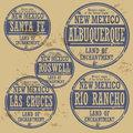 Grunge rubber stamp set with names of new mexico cities Stock Photos