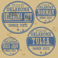 Grunge rubber stamp set with names of oklahoma cities Royalty Free Stock Photo