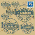 Grunge rubber stamp set with names of pakistan cities Royalty Free Stock Images