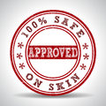 Grunge rubber stamp with the text approved,100% safe on skin Royalty Free Stock Photo