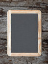 Grunge small blackboard hanging Royalty Free Stock Photography