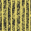 Grunge spotted black and yellow vector seamless pattern. Striped textured background.