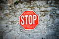 Grunge stop sign red on a stone wall Royalty Free Stock Photos
