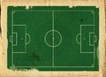 Grunge style llustration of a football pitch soccer on aged textured paper Stock Images