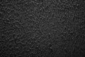Grunge texture, rough ragged dark background, black plaster stuc Royalty Free Stock Photo