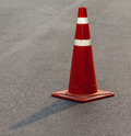 Grunge traffic cone with double white stripe on the street Royalty Free Stock Photo