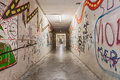 Grunge underpass with graffiti urban underground tunnel light and shadows on pedestrian dark narrow subway alley Royalty Free Stock Image