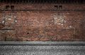 Grunge urban background industrial empty street with warehouse brick wall Stock Photos