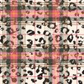 Scottish tartan with leopard skin spots Royalty Free Stock Photo