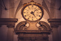 Grunge vintage clock on antique building dark Stock Photography