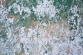 Grunge wall texture background. Paint cracking off dark wall with rust underneath. Royalty Free Stock Photo