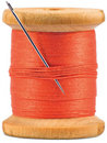 Grunge wooden bobbin with red thread isolated Stock Photo
