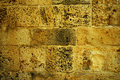 Grunge yellow brick wall Stock Photography