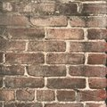 Grungy brown brick wall close up with paint splashes Royalty Free Stock Photo