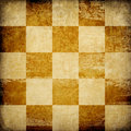 Grungy chessboard stained background. Stock Images