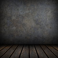 Grungy concrete and wood wall and floor. Royalty Free Stock Photo