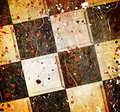 Grungy dotted chessboard background with stains Stock Photo