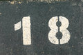 Grungy eighteen years old peeling and cracking paint of house number Royalty Free Stock Photos