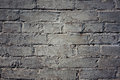 Grungy gray background of bricks and cement old wall texture. Royalty Free Stock Photo