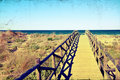 Grungy image of beach bridge Stock Image