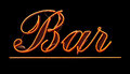Grungy isolated neon bar sign against black background Stock Images