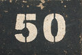 The grungy number fifty aged and cracked paint of Stock Image