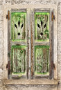 A Grungy old green wooden window Royalty Free Stock Photo