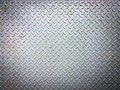 Grungy old weathered metal diamond plate Royalty Free Stock Photo