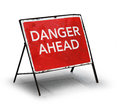 Grungy road sign danger ahead on white background Stock Images