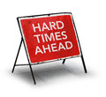 Grungy road sign hard times ahead on white background Royalty Free Stock Images