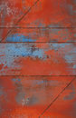 Grungy and rusty metal background with seams a red blue Royalty Free Stock Photo