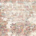 Grungy shabby vintage brick wall with floral pattern Royalty Free Stock Photo
