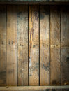 Grungy stained and weathered wooden table background texture of a top with a line of old nails parallel vertical planks Stock Photography