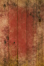 Grungy wood planking photograph of processed to give a red tint and a weathered appearance of a border of powdery sand grubby Royalty Free Stock Photos
