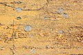 Grungy yellow paint on wood Royalty Free Stock Photo
