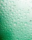 A água verde deixa cair background.close acima de Fotografia de Stock Royalty Free