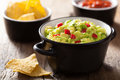 Guacamole with avocado, lime, chili and tortilla chips Stock Image