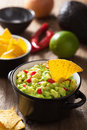 Guacamole with avocado, lime, chili and tortilla chips Royalty Free Stock Images