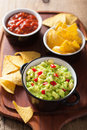 Guacamole with avocado, lime, chili and tortilla chips, salsa Stock Image