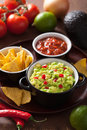 Guacamole with avocado, lime, chili and tortilla chips, salsa Stock Images