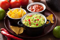 Guacamole with avocado lime chili and tortilla chips salsa limes Royalty Free Stock Photography