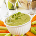 Guacamole with Carrot and Celery Sticks Royalty Free Stock Photography