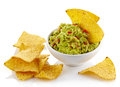 Guacamole dip and nachos bowl of isolated on white background Royalty Free Stock Image