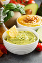 Guacamole and hummus in white bowls Royalty Free Stock Photo