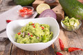 Guacamole and ingredients Royalty Free Stock Photo