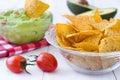 Guacamole with nachos avocado on white wood Stock Images