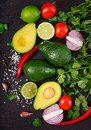 Guacamole sauce ingredients - avocado, tomato, onion, pepper chili, garlic, cilantro, lime Royalty Free Stock Photo