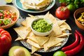 Guacamole, tortilla chips and salsa. Mexican food selection Royalty Free Stock Photo