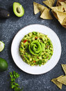 Guacamole and tortilla chips on stone background Royalty Free Stock Photo