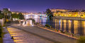 Guadalquivir river seville is divided in two by the on the east side it is located the torre del sol and on the west the triana Stock Photography